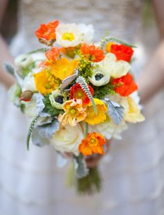 Poppy and Anemone bouquet, but swap out the orange for red to go with the strawberry theme and add little white and yellow daisies?