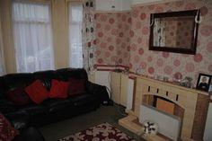 "14' 2"" x 10' 9"" (4.32m x 3.28m) Living room with fireplace, cornice, picture rail & carpet flooring | 284 Woodstock Road, Belfast | Propertynews.com"