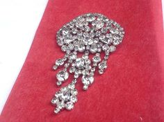 REDUCED!! WAS $225.......NOW $165.00!    Offered is this hear-stopping Juliana brooch in all clear rhinestones. It is in wonderful condition