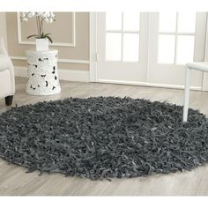 This beautiful leather shag rug will add a casual warmth to your home. It's made from strips of genuine leather, which gives it a soft and comfortable feel, and it comes in an understated gray that will enhance, but not overwhelm, your decor.