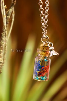 Necklace with glass vial and cap / Flower Charm https://www.etsy.com/listing/156367286/necklace-with-glass-vial-and-cap-rea