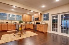 Expansive, BREATHTAKING KITCHEN with granite counters is the hallmark of this abode!