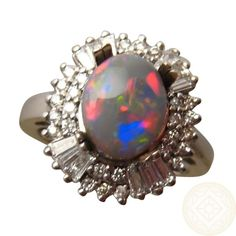 <p> Harlequin Black Opal and Diamond Ring in 14k Gold. Available in any Ring Size and Gold Color preference. One Only</p>