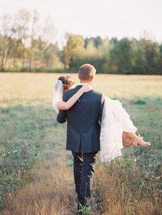 Wedding Photography   Groom carrying Bride