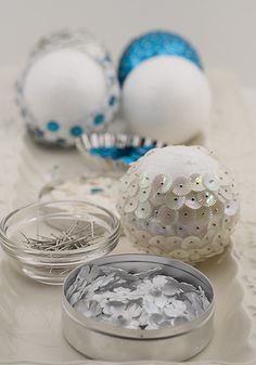 straight pins + Sequins + Styrofoam = beautiful ornaments...really I'd love to just have a bowl full of them during the holidays