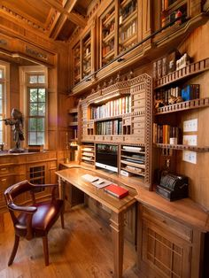 Love the warm woods here and an actual space to write on in front of the computer.