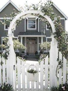 Gateway arbor, w/ fresh flowers pot. Nice way to frame the entry. #cottagelandscapefrontyard