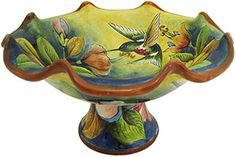 Majolica pottery originated in the 16th century and is primarily distinguished by the milky-white glaze used after the first firing.  Majolica pottery is a diverse category of clay arts under which, Spanish-influenced Talavera and Italian Maiolica are sub-genres.  Mexican Majolica primarily differs from traditional Talavera in the art form and use of colors.  Traditional Talavera is known for its intricate pattern work whereas Majolica uses more free-form designs and artwork. Mexican Artwork, Form Design, Italian Renaissance, Glazes For Pottery, 16th Century, Canisters, Clay Art, Art Forms, Decorative Bowls