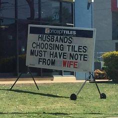 A sign outside a tile shop, husbands beware!