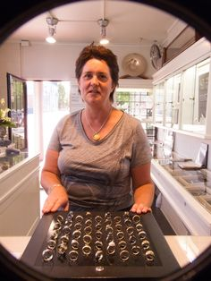 Nicola Rae, the winner of the 2012 Art in Windows Voter's Prize - a Jens Hansen voucher she used to buy a resin pendant, gold leaf chain, and classic Jens Hansen silver bangle.