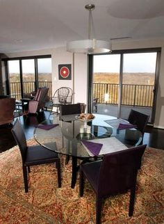 Pictured is the dining room of a College Hill penthouse condo
