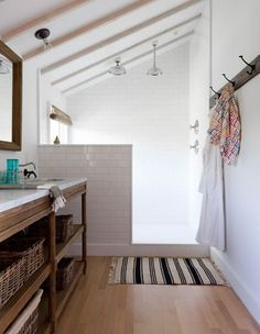 """I like the white tile + ceiling with wood floor and darker wood vanity. Clean and simple, while also feeling warm and a little rustic (i.e., not too modern or """"cold""""). The one thing I would change is to have a floating vanity."""