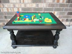 Just a little Creativity: Make a LEGO Table from and Old End Table {DIY} -- love turned wood legs and remewed charm over laminate particle board IKEA Lego tables... But I do love IKEA!!
