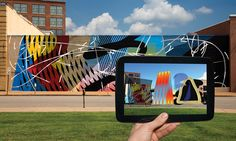 Re+Public completed an interactive mural on the Moto Museum wall at Grand Center on Sept. Our team embedded 14 basic shapes in the painted mural. Ar Reality, Tableaux D'inspiration, Augmented Reality Technology, Mural Art, Murals, Ares, Street Art Graffiti, Art World, Landscape Architecture
