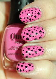 Pink nails with black stars,