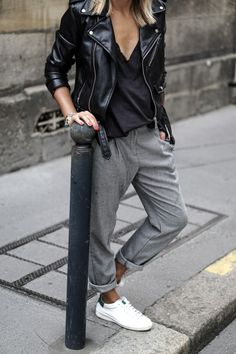 chic and relaxed street style pairing sneakers with a loose trousers and a structured leather jaket