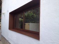 Ventana de aluminio fabricada en carpintería de aluminio acabado acero corten.