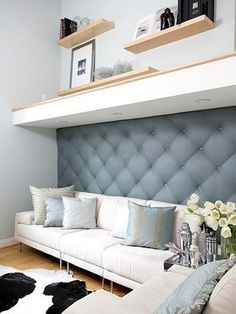 diy project: tufted upholstered wall as a backdrop. Adds a sophisticated texture to the room