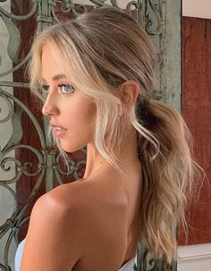 Keep your ponytail sweet and low, making sure to pull out wispies to frame the face. # middle part Hairstyles long 13 Pretty New Ways to Style a Middle Part Old Hairstyles, Wedding Hairstyles, Wedding Updo, Celebrity Hairstyles, Southern Hairstyles, Banana Clip Hairstyles, Birthday Hairstyles, Beach Hairstyles, Quinceanera Hairstyles