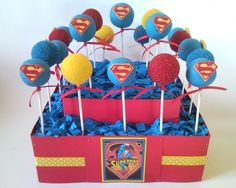 Superman Cake Pop Display (These would be cute in the Superman cups from Walmart. I'm thinking I could also add a cape in fondant instead of that red tie around the stick...)