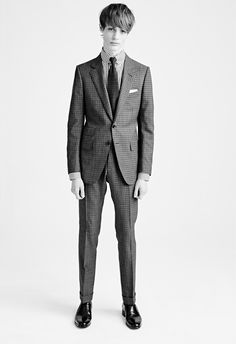 MEN'S AW15 LOOK 10 | Grey bicolor gingham notch lapel buckley jacket.  Black high definition stripe tab collar tailored fit barrel cuff shirt.  Grey bicolor gingham buckley 18cm pant with belt loops.  White cotton pocket square.  Military green flat point silk knitted tie.  Dark brown brushed calfskin bulwer high vamp elastic side loafer.