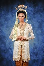 Javanese bride with jasmine flowers in her hair.