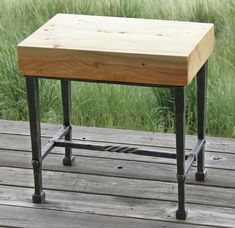End table with tapered legs, square-pad feet, rope-twist stretcher, mortise-and-tenon-rivet joinery. One-piece, Douglas Fir top.