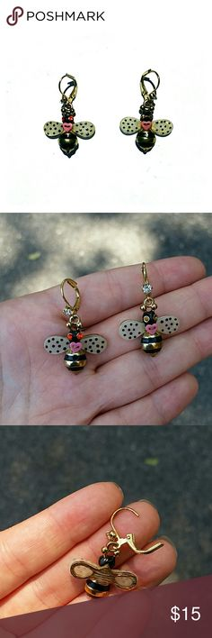 Betsy Johnson Bee Earrings Betsy Johnson Bee Earrings in faux gold, both have clasp closure.  One bee has orange eyes and the other has yellow eyes. Betsey Johnson Jewelry Earrings