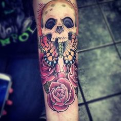 Awesome tattoo on the arm - skull, butterfly and 3 roses. #tattoo #tattoos #ink