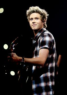 """ Niall Horan of One Direction performs onstage during the 2014 iHeartRadio Music Festival"""