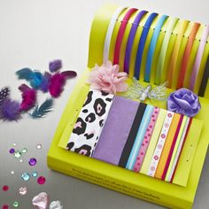 The Creativity for Kids Fashion Headbands set has everything you need to create 10 spectacular hair accessories. It would make a lovely gift, or a good group activity for a playdate or birthday party. The Creativity for Kids Fashion Headbands set is suitable for children aged five and up. The Creativity for Kids Fashion Headbands set contains: 10 satin headbands in a rainbow of bright colours, plus a lavish selection of rhinestones, flowers, feathers, butterflies and ribbons.