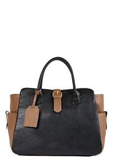 A fashionable and functional masculine-inspired tote. The Pantheon by JustFab features rich two-toned material, buckle accents, and gusset pockets.