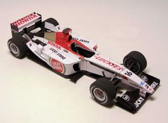 This F1 paper car is a 2003 GP Japan BAR 005 (driven by Takuma Sato), a Formula One racing car which the British American Racing team used to compete in the 2003 Formula One season, the paper model is created by PKAA, and the scale is in 1:24.