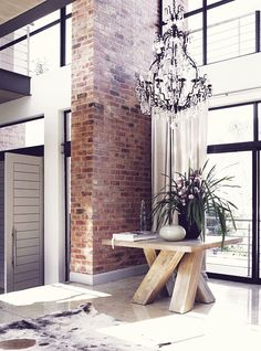 big entry table + chandelier + exposed brick, must have lights, moder interior, stylish interior. Home Interior, Interior Architecture, Interior And Exterior, Interior Decorating, Interior Livingroom, Decorating Ideas, Hall Deco, Attic Renovation, Attic Remodel