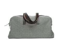 My favorite thing about this classic Everlane option is that it goes with absolutely everything, and the sturdy twill fabric and leather straps ensure it will last for many trips. $95