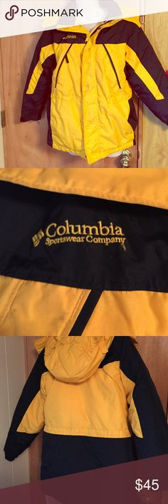 Columbia  sportswear women's medium jacket Like new condition I only wear this coat a couple of times. Columbia coat means it's super warm it has all the pockets zippers etc. that you expect from a Columbia coat. Colors are black and gold. Comes from a smoke free home. This is an awesome coat  for the price. Columbia Jackets & Coats Puffers