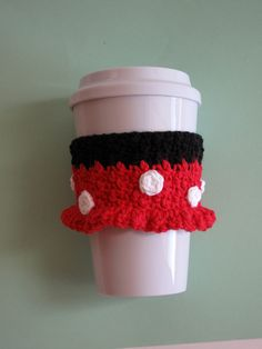Minnie Mouse inspired crocheted coffee cup cozy. Keep your hands safe from hot coffee cups. Feel good about helping the environment too