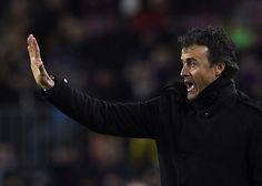 Barcelona's coach Luis Enrique gestures during the Spanish league football match FC Barcelona vs Villarreal CF at the Camp Nou stadium in Barcelona on February 1, 2015.
