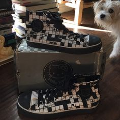 Hello Kitty high top sneaker shoes  Black and White high top hello kitty sneakers (worn a handful of times) fairly good condition minus some miner stains on the tongue covered by the shoelaces comes with original box (rough around the edges) the box and shoes say 9 but feel a little like 9.5-10 ✌️ Hello Kitty Shoes Sneakers