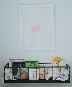 cool book rack/doll's perch beside the bed.  Would love this in the girls' room