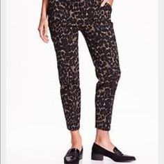 Old navy leopard Harper pants, size 4 Perfect for sooo many occasions.  Hook and bar closure with zip fly, slant pockets in front, welt pockets in back,  soft twill with added stretch, straight through hip and thigh, stovepipe leg-hits at ankle and sits just above the waist.  Spandex/cotton. In excellent condition. Only been worn once! NWOT Old Navy Pants Trousers