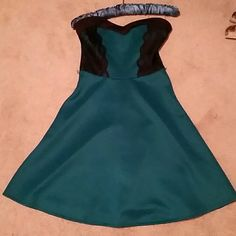 """PRICE DROP! 🎉 Strapless Teal and Lace Dress Super cute teal and black dress. Has loops on the side for a thin belt (included). I'm 5' 3"""" and it rested slightly above my knee. Made of a polyester and spandex blend.  I recently tried the dress on for size, and realized that the zipper is a little finicky. I was able to put the dress on over my head and then unzip it when removing it, and that seemed to work fine! 😊 Price has been dropped accordingly. Dresses Strapless"""