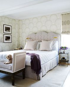 The master bedroom headboard, upholstered in a Rogers & Goffigon linen, was custom made, the throw is by Sferra, the daybed was found in Paris, and the wall paper is by Farrow& Ball.