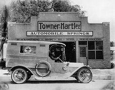 Orange County Hospital ambulance at Towner & Hartley, Santa Ana  by Orange County Archives