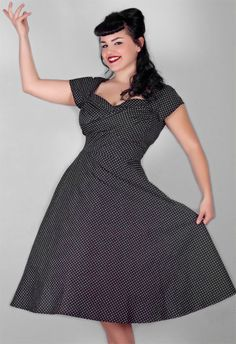 """Sewing idea pic... """"This dress is an ultra stylish scene stealer! This black and white polka dot dress is made out of a soft cotton fabric that has a slight stretch. This dress has a fitted bodice, cap sleeves, full swing skirt and back zip. The wrap twist in the bust area will enhance your bustline. This is a perfect 50's design!"""""""