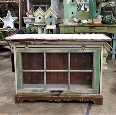 Chippy painted cabinet I built today using an old wood window and my stash of Vintage Beadboard. https://www.facebook.com/Carlasgardenanddecor