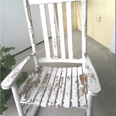 Old rocking chair my sister painted and sanded to look old and worn. Love it! Favorite chair on my back porch besides the mint chair, naturally.