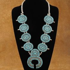 This highly collectible, Circa 1970-1980's, necklace made by master Navajo Silversmith, Larry Moses Begay is truly a thing of beauty. This handmade Navajo necklace features Old Kingman Turquoise in a traditional needlepoint design. Unbelievable, in a word, is the amount of meticulous craftsmanship and patience that Larry used to create this masterpiece of Southwestern jewelry. $1728.00 #Alltribes