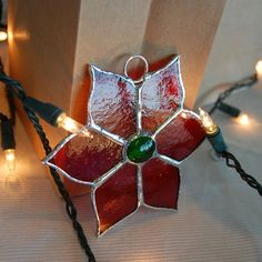 Stained Glass Christmas Poinsettia. $12.00, via Etsy.