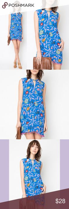 Hayden LA blue floral Pom Pom dress 💜💕 Effortlessly chic and ultra feminine, the Hayden Clothing Trapeze Dress with Cut Outs in Blue is a must-have! This floral dress will pair perfectly with your favorite wedges or boots! Made from a lightweight 100% rayon fabric, this dress has a sleeveless construction and features a fun pom-pom trim along the hemline. Features a trendy keyhole cutout at the back neck with a gold button closure and in the front. Trapeze cut and ready to ship fast…